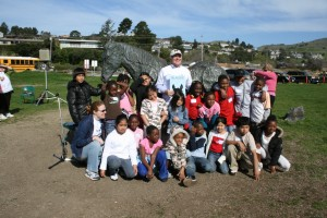 kids from Oakland pose with Christopher Cerf